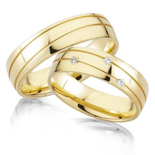 Geelgouden trouwringen met 3 x 0.03 crt. – AD16