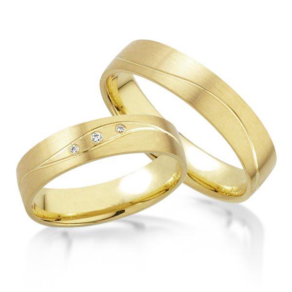 Geelgouden trouwringen met 0.02 crt. – AD29